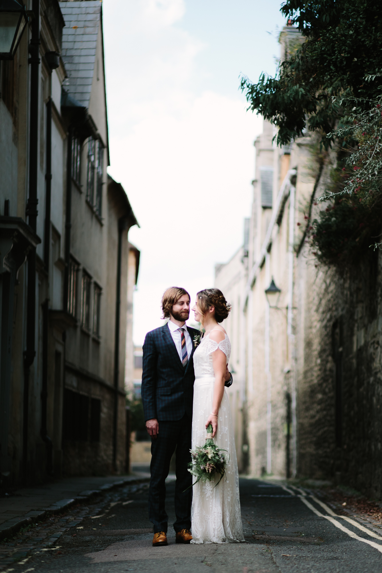 A stunning photo of a bride and groom in the cobbled street of Oxford, before heading off to The Perch Inn