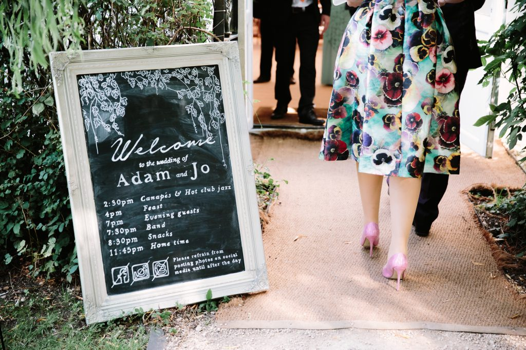 A DIY welcome sign to a wedding at Adam + Jo's wedding at The Perch in Oxford.