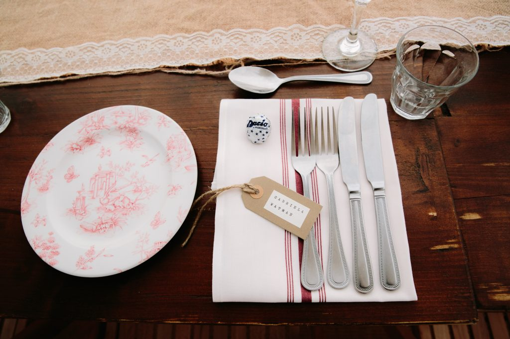 Wedding table settings at The Perch in Oxford. Vintage plates and rustic crockery
