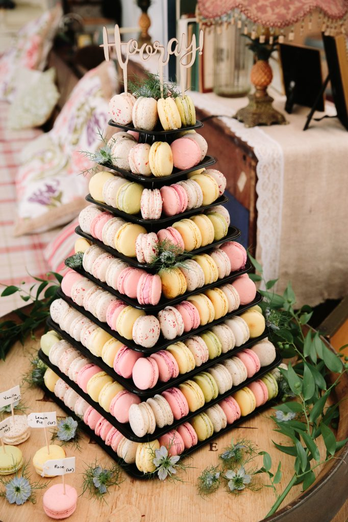 A vegan Macaroon Wedding Cake. Super colourful with a Hooray sign on the top. For Jo and Adam's relaxed wedding at the perch in oxford