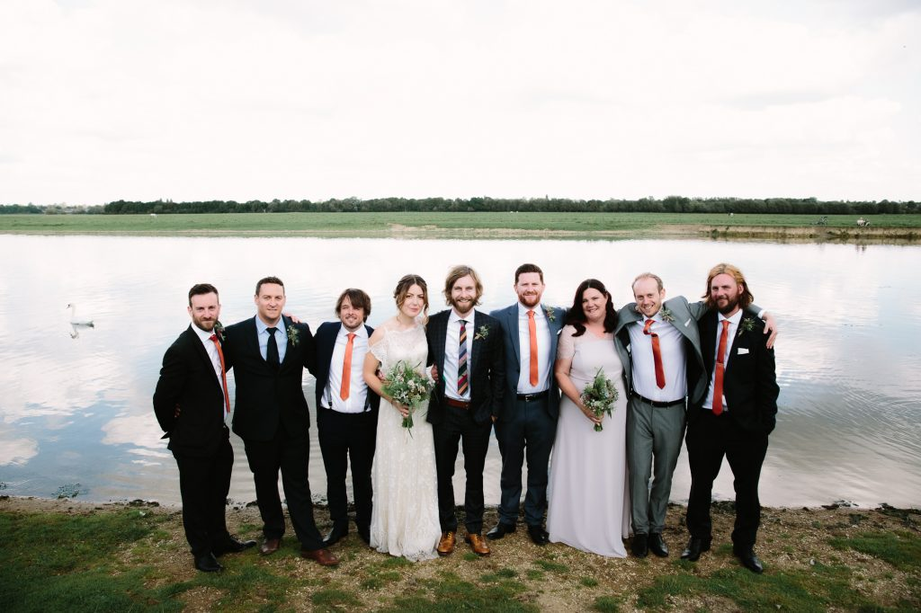 A modern Bridal Party next to the river in Port Meadow in Oxford.