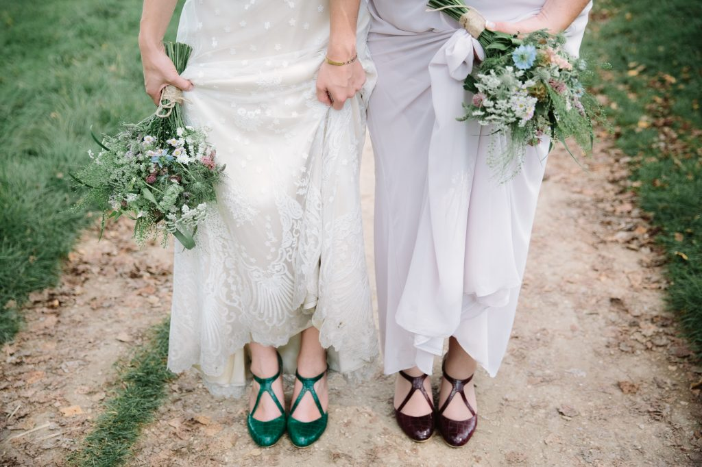 A bride and bridesmaids shoes, worn by the river outside the Perch Pub in Oxford. The shoes are alternative wedding shoes, and alternative vintage wedding dress