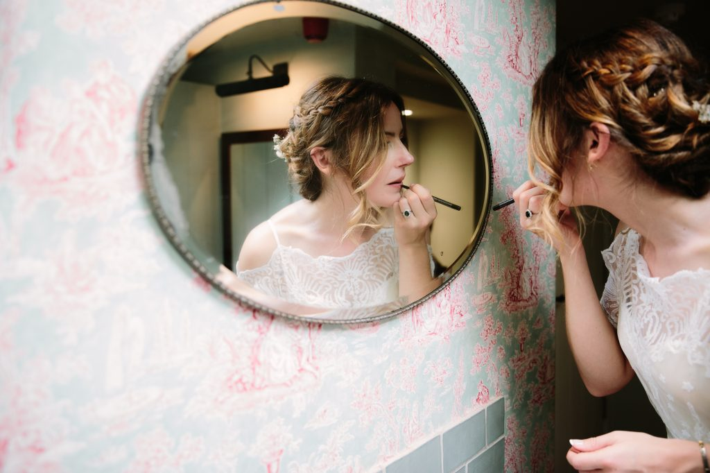 The Perch Oxford Wedding | Bride applying lipstick | www.philippajamesphotography.com
