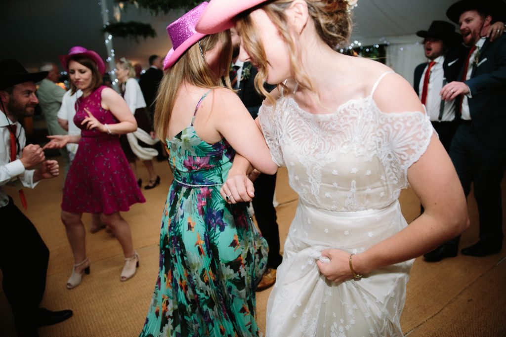 A bride dancing with her mates in a marquee at The Perch Inn, in Oxford