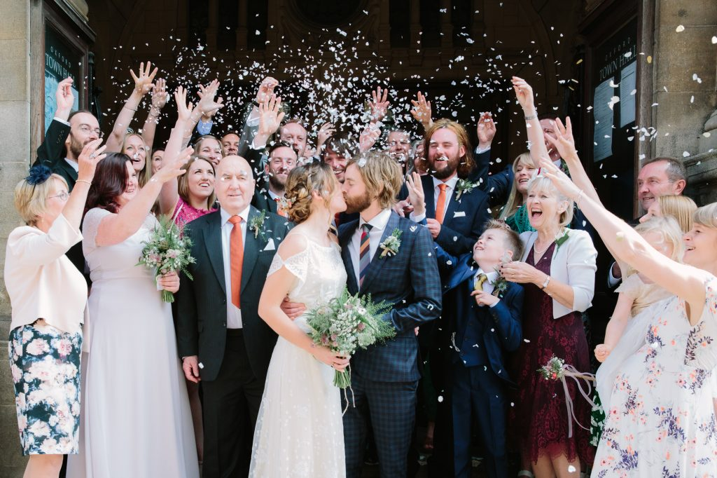 Lots of confetti and happy faces after getting married at oxford town hall. Photos by oxfordshire wedding photographer philippa james photography