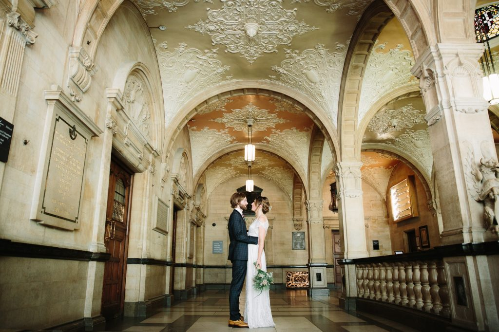 Portraits of the Bride and Groom being in love and all romantic in Oxford Town Hall