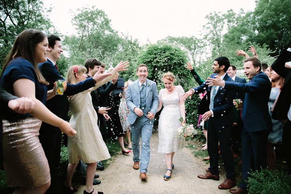 CONFETTI THROWN AT COUPLE AT THE PERCH INN OXFORD - PHOTO BY PHILIPPA JAMES PHOTOGRAPHY
