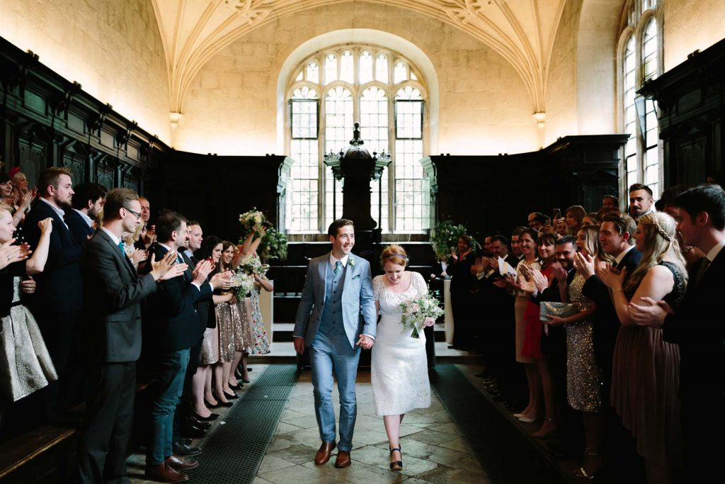 OXFORD WEDDING VENUES - couple exiting the bodlien library