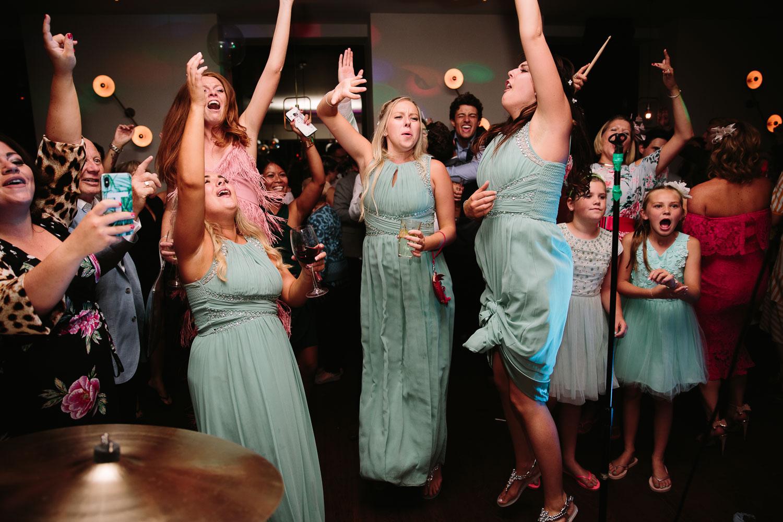 BRIDESMAIDS DANCEING AT A WEDDING