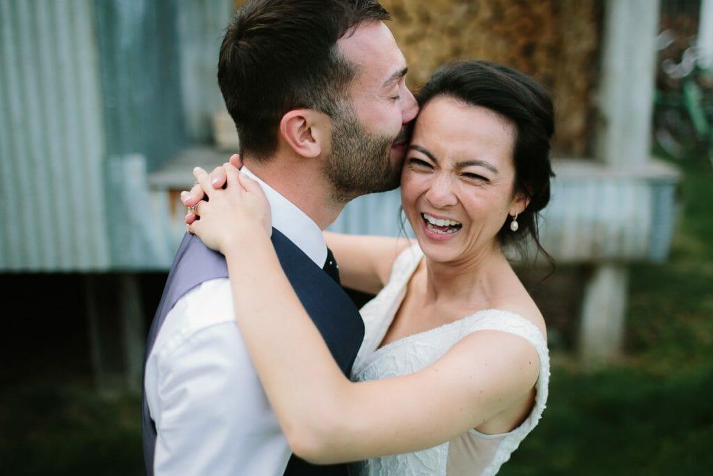 Soho Farmhouse Wedding - Bride + Groom kissing