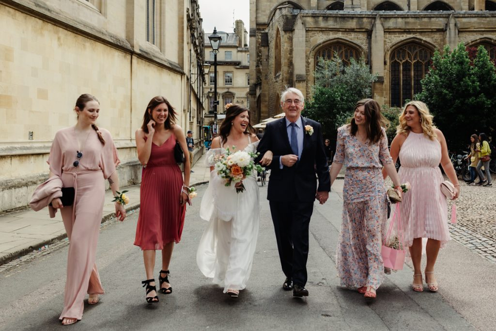 Bride walking through the streets of Oxford - shot by Philippa James Wedding Photographer